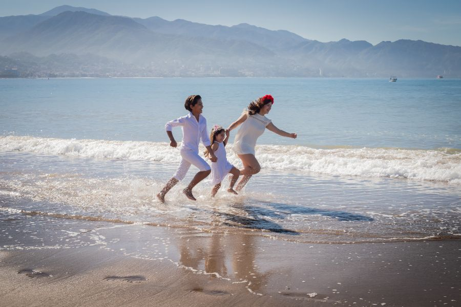 Children Running in Water During Lifestyle Photo Session on Vacation at Sunscape Resort & Spa Captured by Adventure Photos