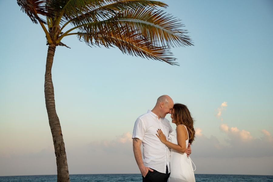 Couple at Sunset Photographed During Wedding Anniversary Vacation by Adventure Photos