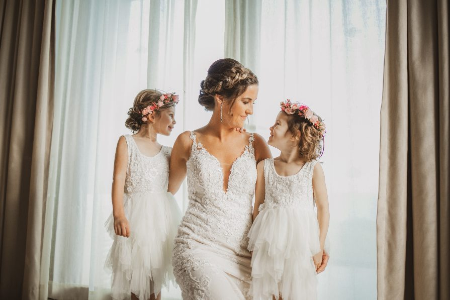 Bride and flower girls during getting ready photos taken by Adventure Photos