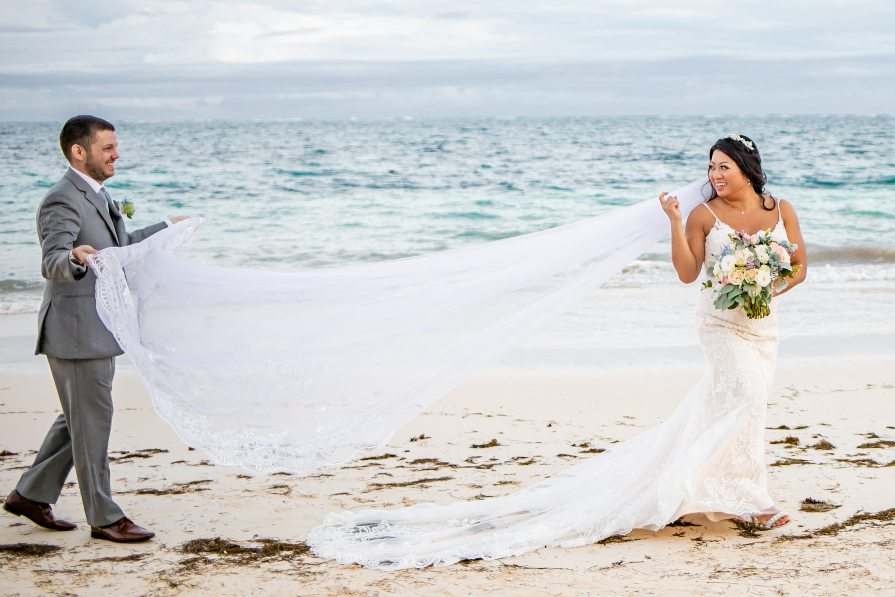 Bride and groom on walking on beach during bridal portrait session with Adventure Photos