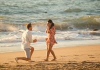 Man proposing to girlfriend on a beach