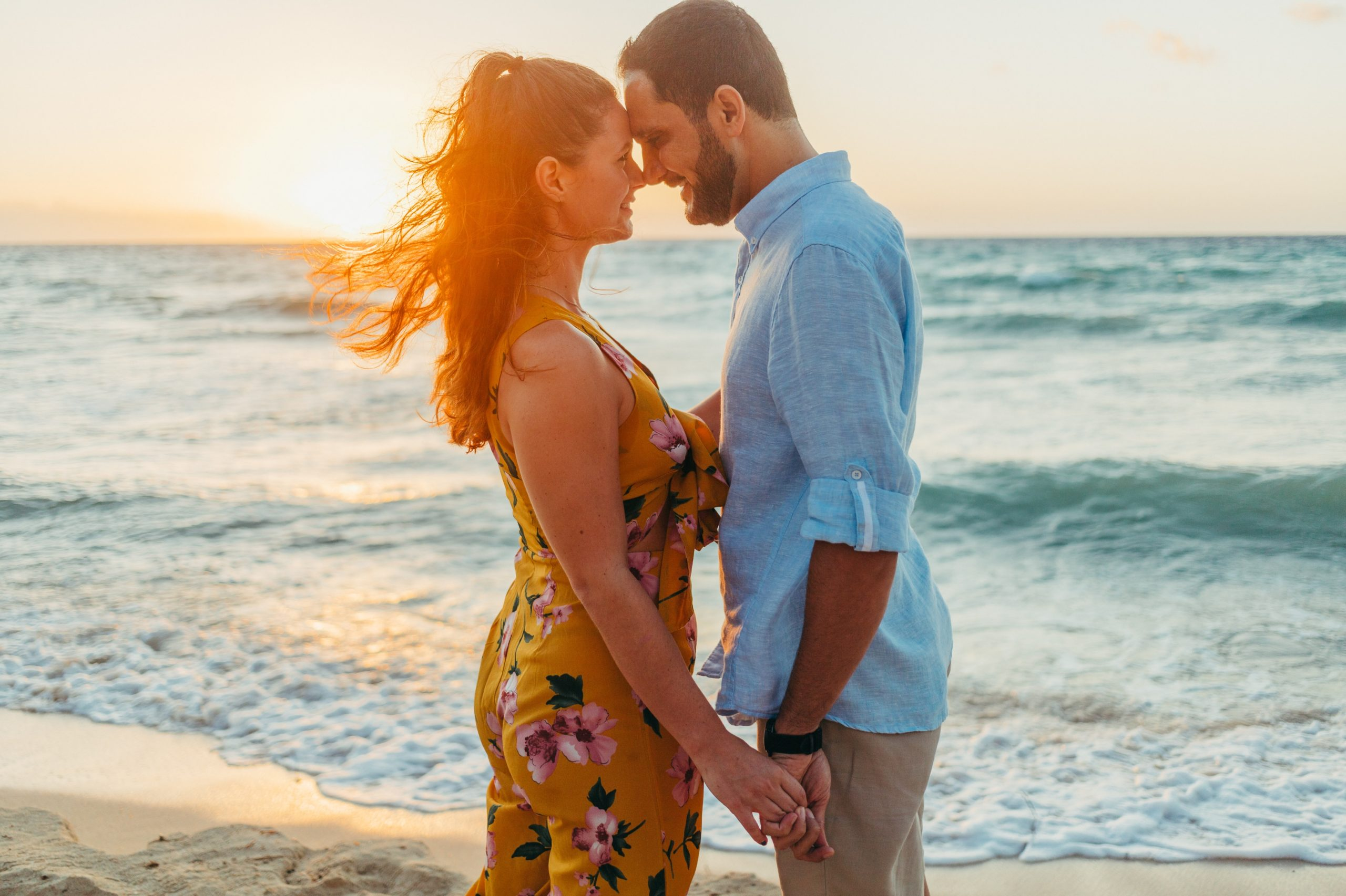 Engagement photo of couple during sunset on a beach