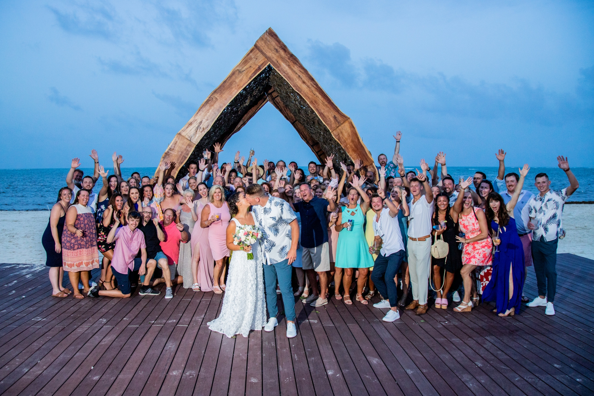 Wedding guests celebrating the newlyweds at a destination wedding