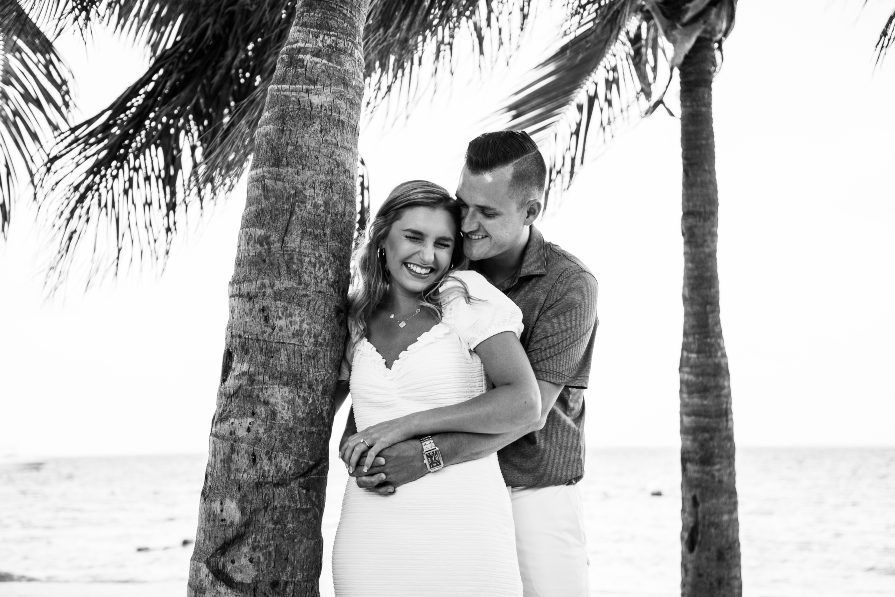 Candid couples photo on the beach during romantic vacation to Dreams Vistas Resort