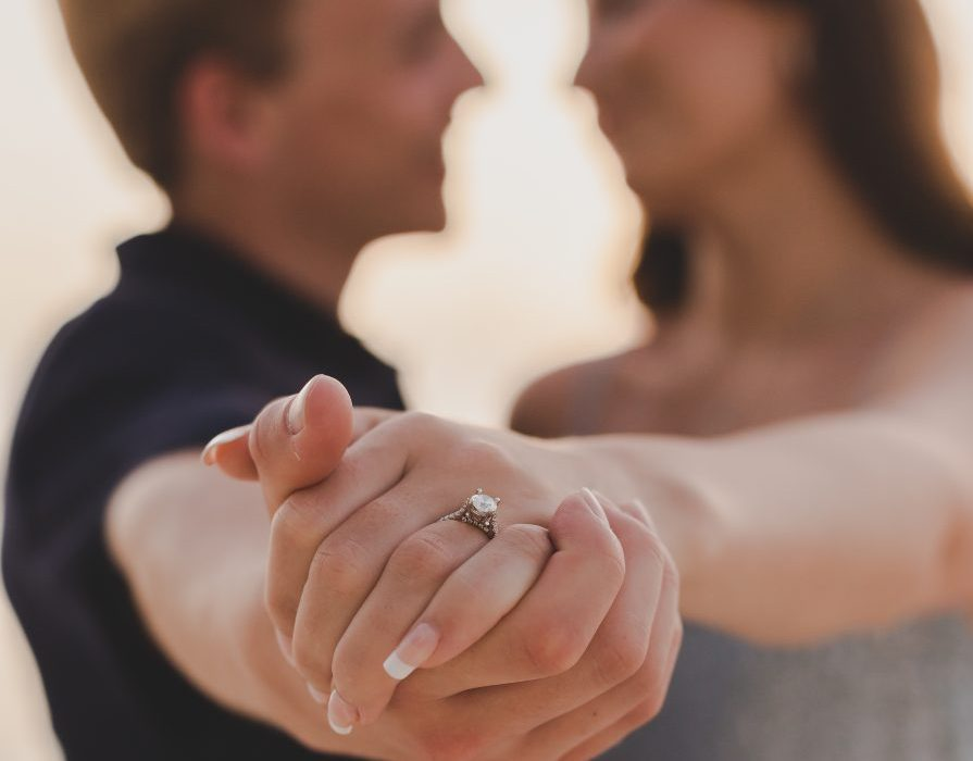 Detail shot of engagement ring during engagement session by Adventure Photos