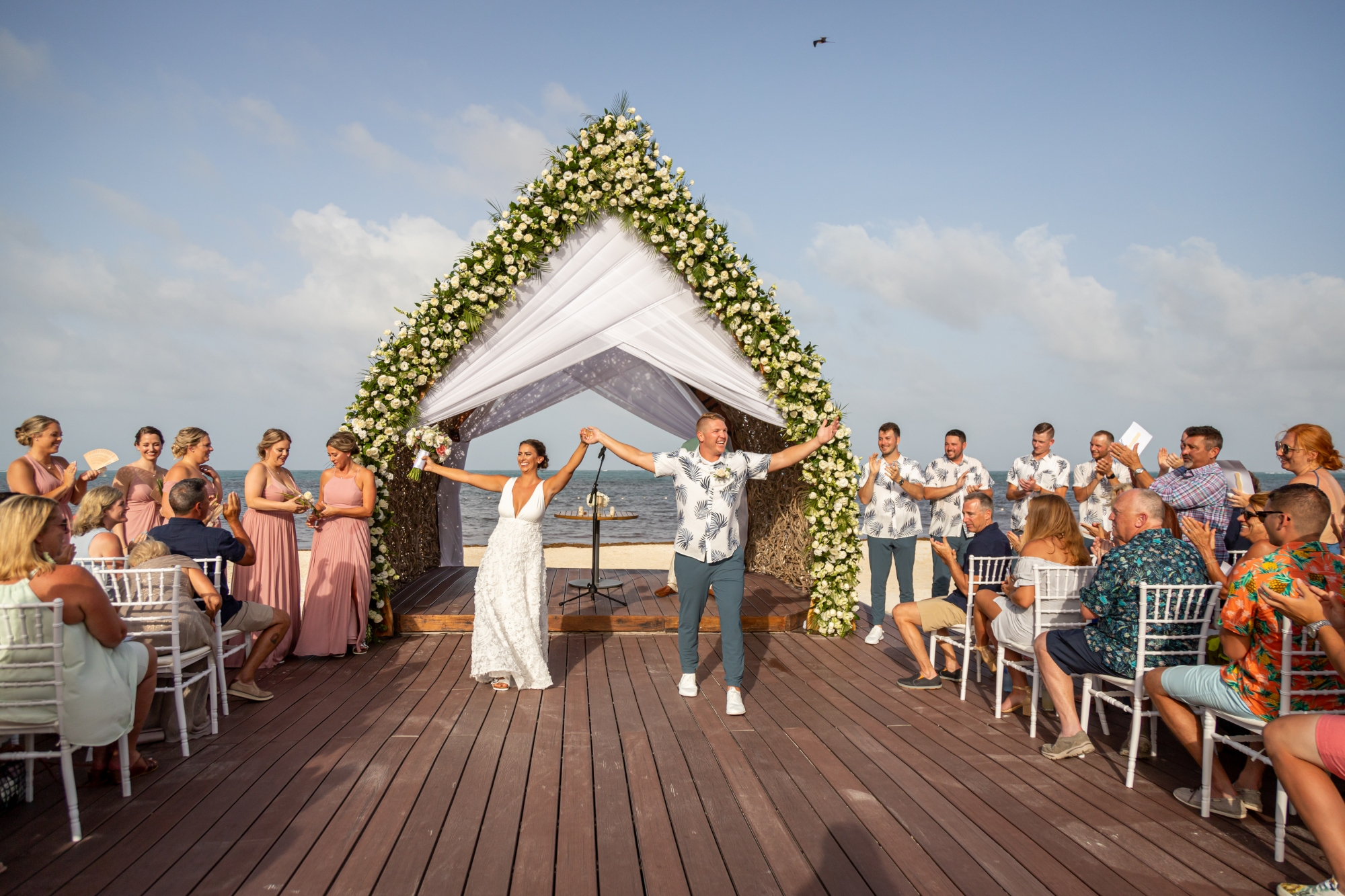 Bride and groom celebrating their marriage at destination wedding