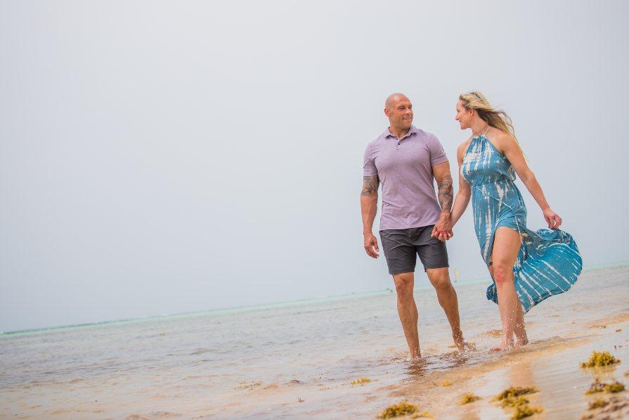 Couple Walking on Beach During Honeymoon Photo Shoot at Secrets Cap Cana by Adventure Photos