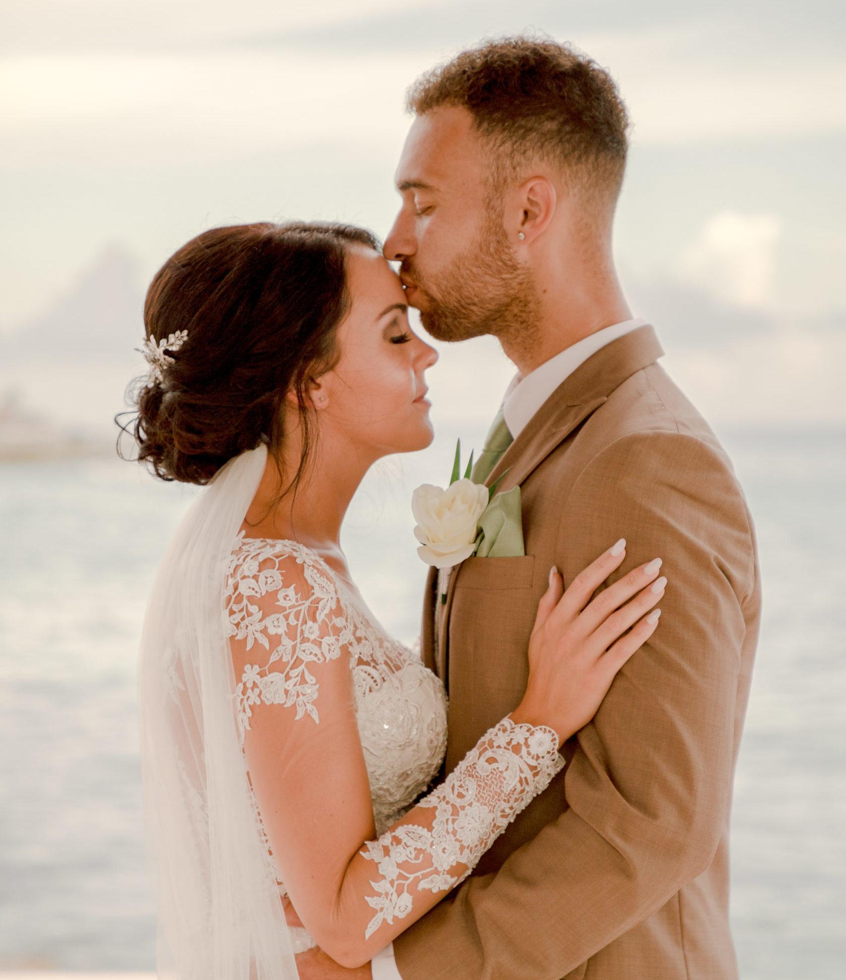 Wedding portrait of a newly wed couple taken taken by Ivan Castelan