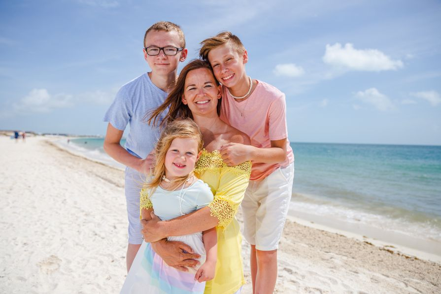 Family Portrait Captured by Adventure Photos Onsite Photographers at Dreams Playa Mujeres