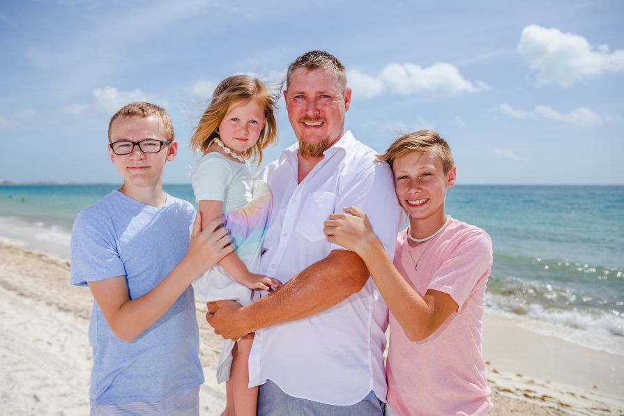 Family Portrait on the Beach During Cancun Vacation Captured by Adventure Photos