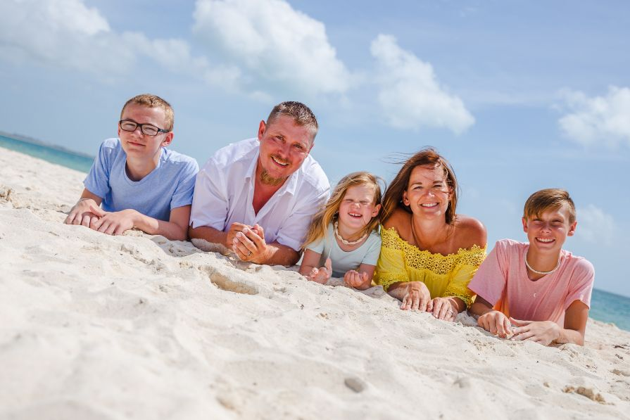 Adorable Family Photo Captured During Beach Photo Shoot with Adventure Photos