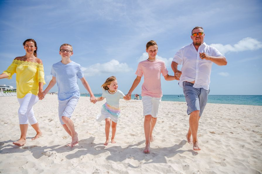 Family Photo Session on Beach During Vacation to Dreams Playa Mujeres